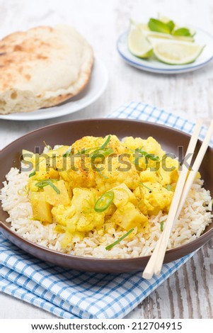 vegetable curry with cauliflower, lime and rice, close-up