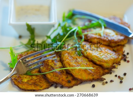 Vegetable fritters with carrots and zucchini. Healthy eating - stock photo