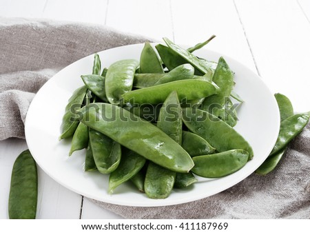 Vegetable. Green peas on a dish - stock photo
