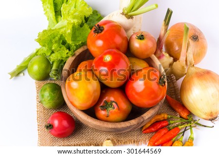 vegetable in wooden bowl on a white background