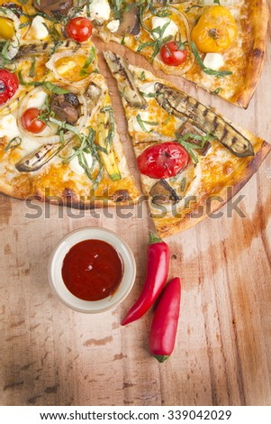 vegetable italian pizza with hot sauce - stock photo