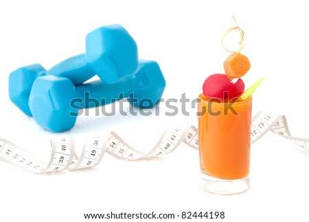 Vegetable juice, tape measure and dumbbells - stock photo
