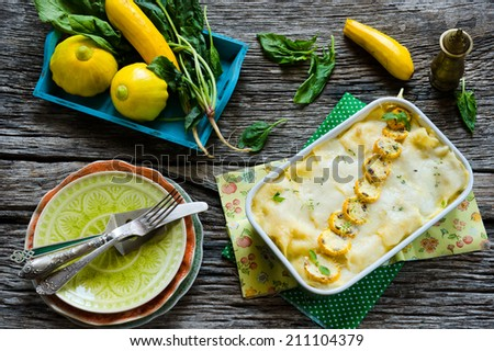 Vegetable lasagna with spinach and yellow zucchini - stock photo