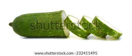 Vegetable marrow with green leaves isolated on white background - stock photo