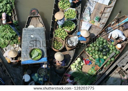 Vegetable merchants at Mekong floating market - stock photo