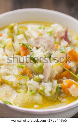 Vegetable minestrone soup with cheese and rice