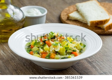 Vegetable minestrone with orzo pasta, zucchini, capsicum, potatoes, carrots, Italian entree - stock photo