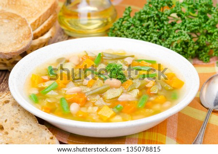 vegetable minestrone with white beans and toast horizontal closeup - stock photo
