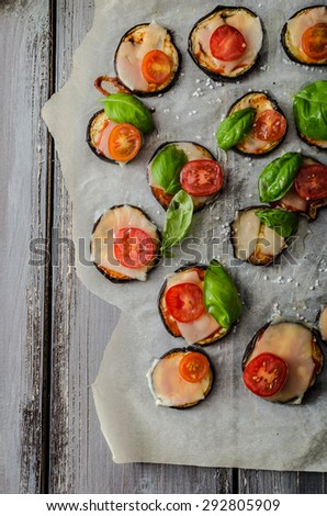 Vegetable mini pizza with eggplant, cheese and basil - stock photo