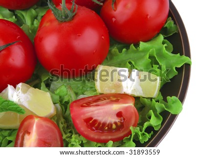 vegetable mix on dark dish over white background
