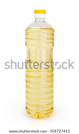 Vegetable oil in bottle isolated on white background with clipping path