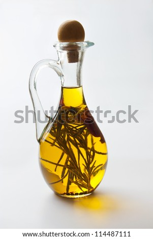 Vegetable oil with spices in a jug - stock photo