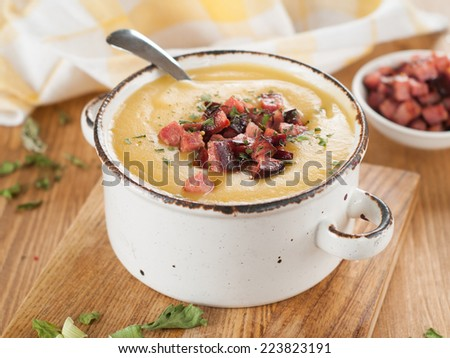 Vegetable or peas cream soup with chorizo, selective focus - stock photo