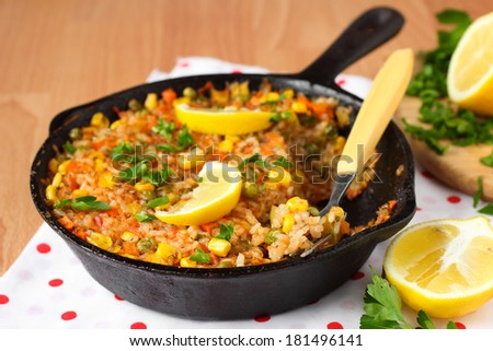 Vegetable paella with corn and green peas