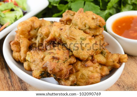 Vegetable Pakora or Onion Bhajis served with salad and chili sauce. - stock photo