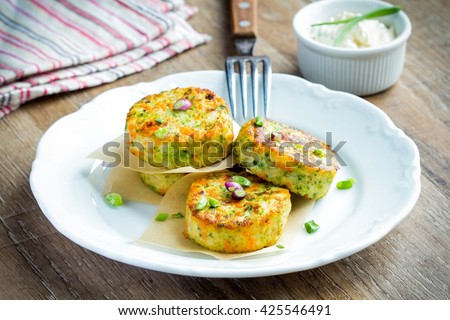 Vegetable pancakes with broccoli, cabbage, vegetarian summer dish, lenten tasty spring lunch - stock photo