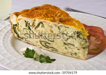 Vegetable quiche in a white dish for lunch. - stock photo