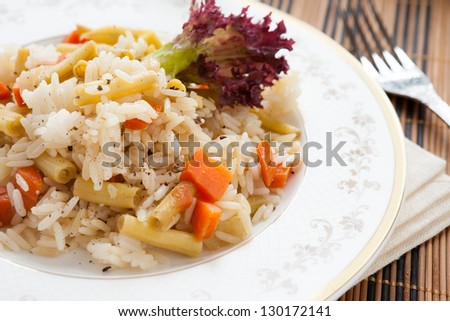 vegetable risotto on white plate, closeup