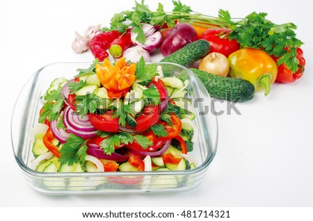 Vegetable salad and fresh vegetables. White background.