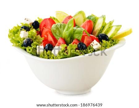 Vegetable salad bowl isolated on white background - stock photo
