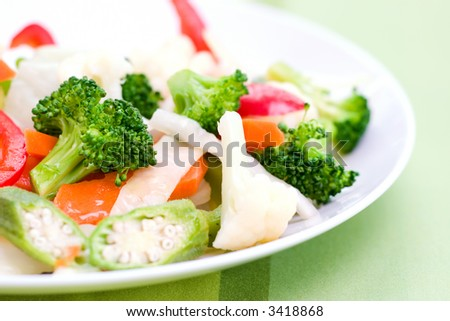 Vegetable salad greens made from broccoli, okra, cauliflower, red pepper lettuce and carrots.