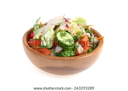 Vegetable salad in a wooden bowl isolated on white background - stock photo