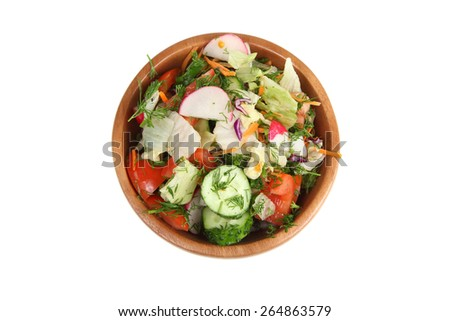 Vegetable salad in a wooden bowl isolated on white background
