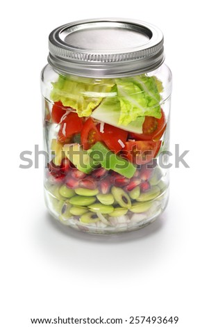 vegetable salad in glass jar isolated on white background - stock photo