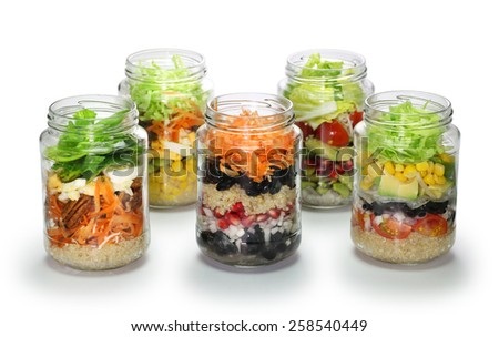 vegetable salad in glass jar on white background, no lid  - stock photo