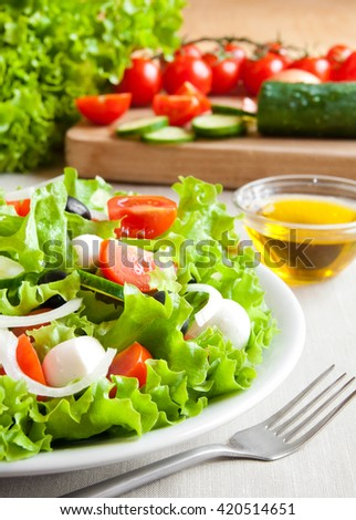 Vegetable salad in white plate - stock photo