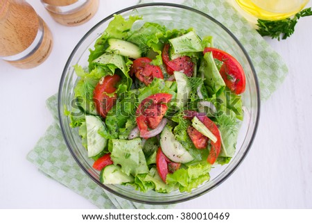 Vegetable salad of tomatoes, cucumbers and lettuce - stock photo