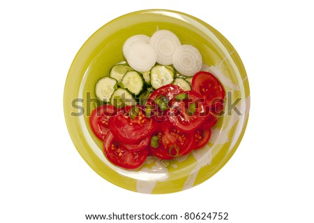 vegetable salad on a  green plate isolated on white