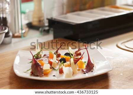 Vegetable salad on a kitchen table