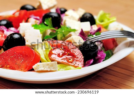 Vegetable salad on wooden table - stock photo