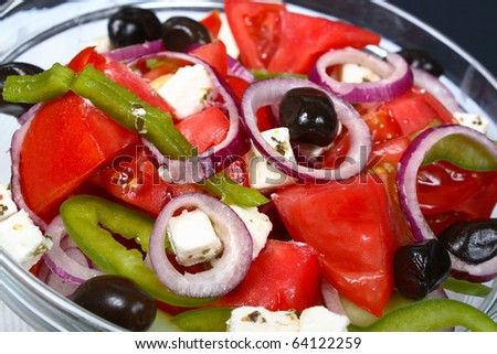Vegetable salad with cheese and olives - stock photo