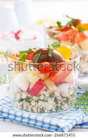 vegetable salad with cottage cheese in a glass, close-up, vertical - stock photo