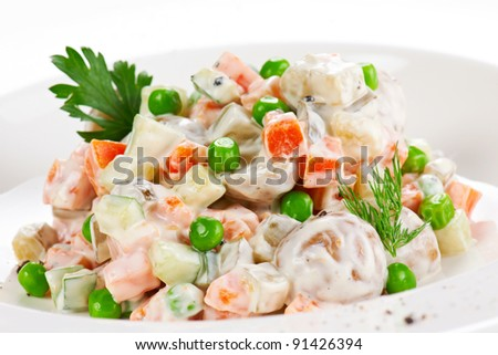 Vegetable salad with green peas and herbs - stock photo