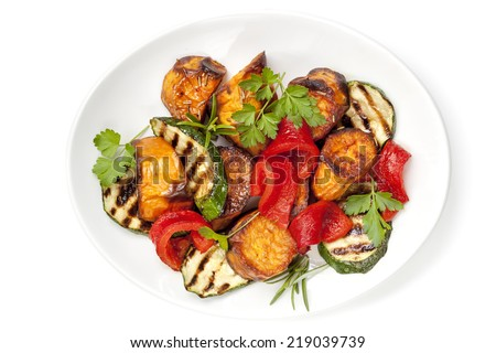 Vegetable salad with grilled red capsicum, sweet potato, zucchini and parsley. - stock photo