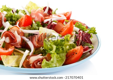 Vegetable salad with ham on white background