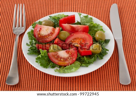 vegetable salad with olives on the plate