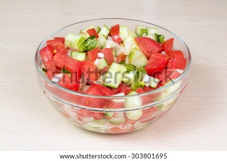 Vegetable salad with onion, tomato and cucumber