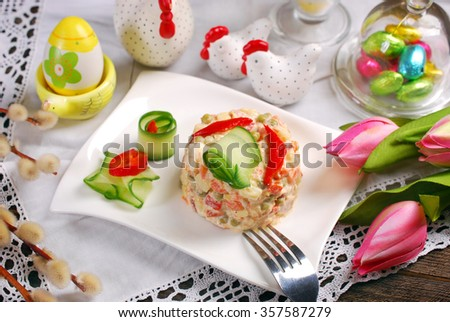 vegetable salad with potato,carrot,peas,pepper,egg,ham and mayonnaise for easter - stock photo