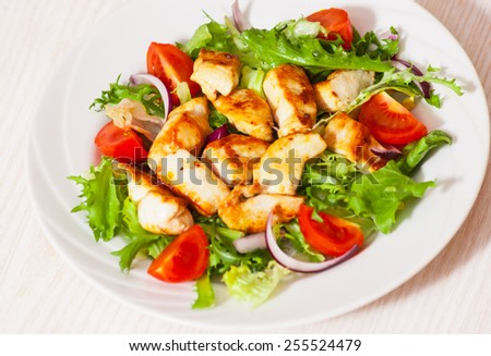 Vegetable salad with roasted chicken breast - stock photo