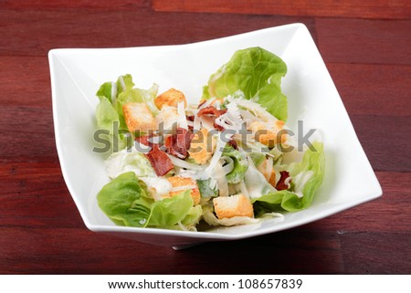 Vegetable salad with salman ,tometo , bread on white plate.