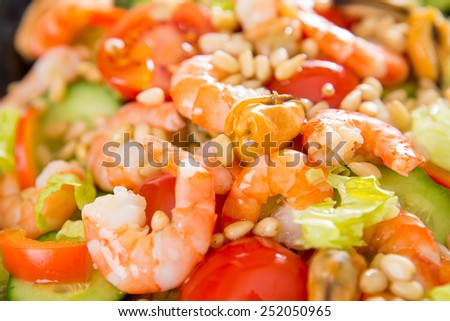 Vegetable salad with shrimp and mussels on a white background.
