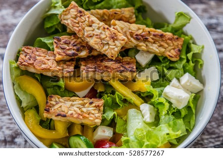 Vegetable salad with tempe goreng, fried tempeh, Bali Island, Indonesia