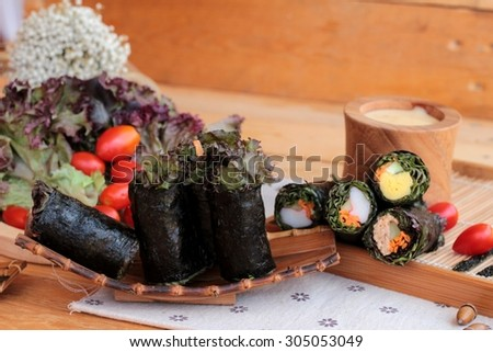 Vegetable salad wrapped with seaweed into spring rolls