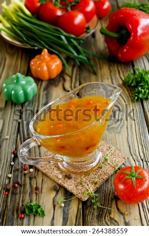 Vegetable sauce on wooden table - stock photo