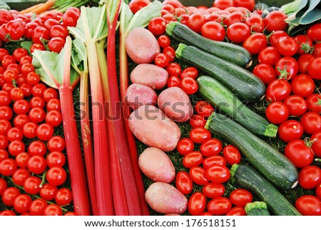Vegetable Selection with Tomato, Potato, Courgette, and Rhubarb   - stock photo