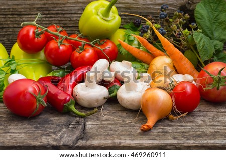 Vegetable set on a wooden background. Close-up